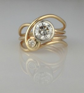"""""""Horizon"""" Ring made using client's vintage diamonds and gold."""