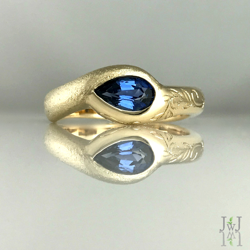 Engraved sandcast sapphire ring