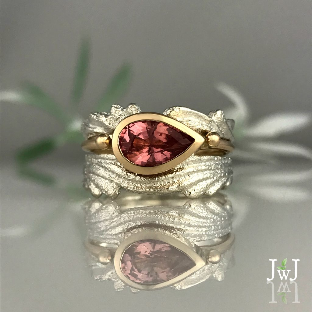The Pink Sapphire Ripple Ring is Ocean Inspired and cast in sand.