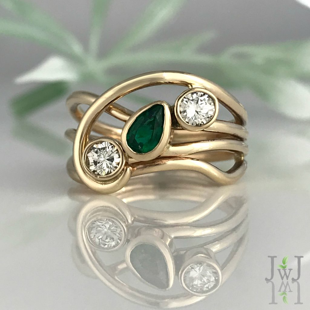 A Green Horizon Ring of recycled gold, recycled Diamonds and a beautiful Emerald.